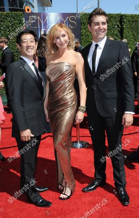 From left, Grant Imahara, Kari Byron, and Tory Belleci arrive at the 2014 Creative Arts Emmys at Nokia Theatre L.A. LIVE, in Los Angeles