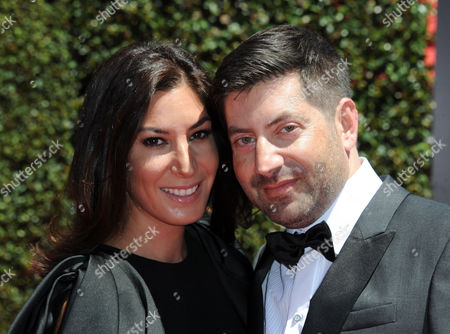 Suzann Levine, left, and James S. Levine arrive at the 2014 Creative Arts Emmys at Nokia Theatre L.A. LIVE, in Los Angeles
