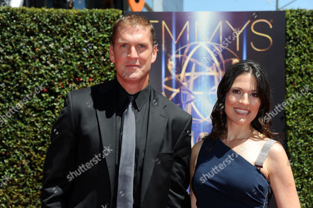 Stock Image of Regan Burns, left, and Jennifer Burns arrive at the 2014 Creative Arts Emmys at Nokia Theatre L.A. LIVE, in Los Angeles