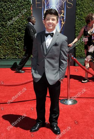 Bradley Steven Perry arrives at the 2014 Creative Arts Emmys at Nokia Theatre L.A. LIVE, in Los Angeles
