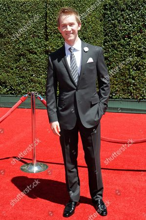 Jason Dolley arrives at the 2014 Creative Arts Emmys at Nokia Theatre L.A. LIVE, in Los Angeles