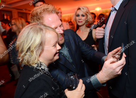 Lauren Potter, left, and Jesse Tyler Ferguson attend Entertainment Weekly's Pre-Emmy Party sponsored by L'Oreal Paris and Hearts On Fire at Fig & Olive in West Hollywood, Calif. on