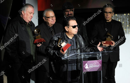 Cesar Rosas, center, and from left, David Hidalgo, Conrad Lozano, Steve Berlin and Louie Perez, of the musical group Los Lobos, accept the 2014 Lifetime Achievement Award on stage at the Latin Grammys - Special Merit Awards at the Hollywood Theatre at the MGM Grand Hotel and Casino, in Las Vegas