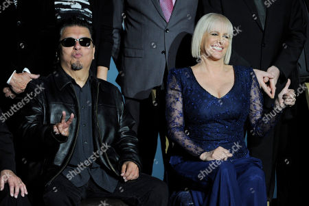Winners of the 2014 Lifetime Achievement Award Cesar Rosas, of the musical group Los Lobos, left, and Valeria Lynch pose on stage at the Latin Grammys - Special Merit Awards at the Hollywood Theatre at the MGM Grand Hotel and Casino, in Las Vegas