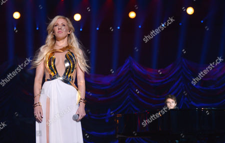 Ellie Goulding, left, and Zedd perform on stage at the MTV Movie Awards,, in Los Angeles