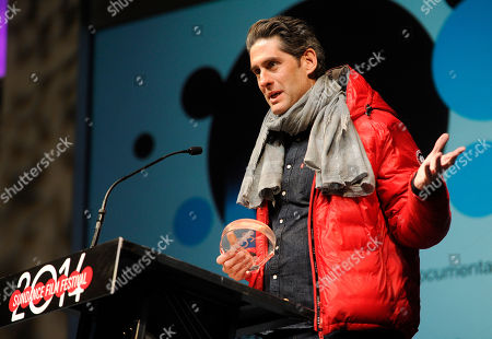 """Stock Image of Nadav Schirman, director of """"The Green Prince,"""" accepts the Audience Award: World Cinema Documentary during the 2014 Sundance Film Festival Awards Ceremony, in Park City, Utah"""