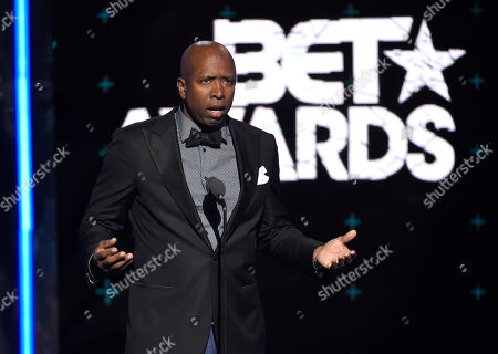 Kenny Smith presents an in memoriam tribute to Stuart Scott at the BET Awards at the Microsoft Theater, in Los Angeles