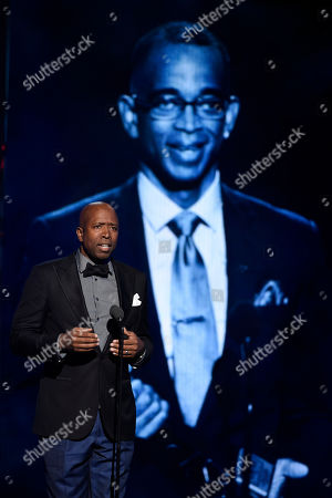 Stock Image of Kenny Smith presents an in memoriam tribute to Stuart Scott at the BET Awards at the Microsoft Theater, in Los Angeles