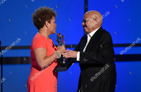 Chairman and CEO of BET Debra Lee, left, presents the humanitarian award to Tom Joyner at the BET Awards at the Microsoft Theater, in Los Angeles