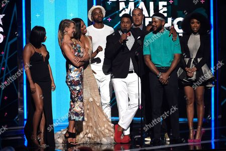 Lauren London, from left, Brittany Daniel, Wendy Raquel Robinson, Jay Ellis, Pooch Hall, Coby Bell, Barry Floyd, Hosea Chanchez, and Brandy Norwood present the award for best male hip hop artist at the BET Awards at the Microsoft Theater, in Los Angeles