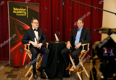 "Trevor Worley, left, of American Film Institute, winner of the award for best comedy for ""Martian American"", participates in an interview with Steve Levitan at the 36th College Television Awards, presented by the Television Academy Foundation at the Skirball Cultural Center in Los Angeles on"
