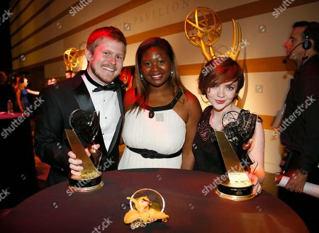 "JP Keenan, and from left, Aryelle Cormier, and Rachel Lewis-Krisky of Ithaca College pose with the second place award for best documentary for ""Fighter by Nature"" at the 36th College Television Awards, presented by the Television Academy Foundation at the Skirball Cultural Center in Los Angeles on"