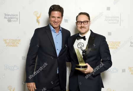 "Steve Levitan, left, and Trevor Worley of American Film Institute pose for a portrait with the award for best comedy for ""Martian American"" at the 36th College Television Awards, presented by the Television Academy Foundation at the Skirball Cultural Center in Los Angeles on"