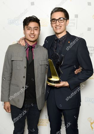 """Stock Picture of Presenter Edward Bean, left, and Christopher Campbell of Art Center College of Design pose for a portrait with the first place award for Commercial """"Maglite - Dreamweaver"""" at the 36th College Television Awards, presented by the Television Academy Foundation at the Skirball Cultural Center in Los Angeles on"""