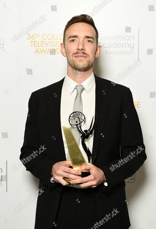 """Henry Hughes of American Film Institute poses for a portrait with the Directing Award for """"Day One"""" at the 36th College Television Awards, presented by the Television Academy Foundation at the Skirball Cultural Center in Los Angeles on"""