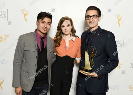 """Presenter Edward Bean, and from left, Danielle Panabaker pose for a portrait with Christopher Campbell of Art Center College of Design with the first place award for Commercial """"Maglite - Dreamweaver"""" at the 36th College Television Awards, presented by the Television Academy Foundation at the Skirball Cultural Center in Los Angeles on"""