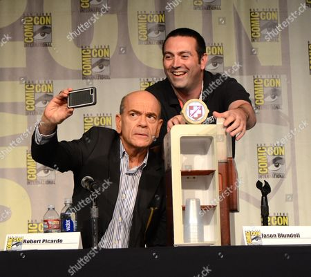 "Robert Picardo, left, and producer Jason Blundell take a photo at the ""Call of Duty Black Ops III: Zombie World"" panel on day 1 of Comic-Con International, in San Diego, Calif"