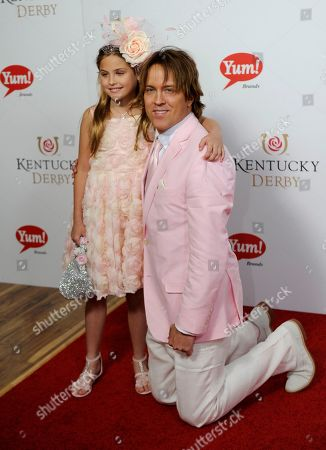 Larry Birkhead (right) and his daughter Dannielynn arrive on the red carpet at the 2015 Kentucky Derby on at Churchill Downs in Louisville, Ky