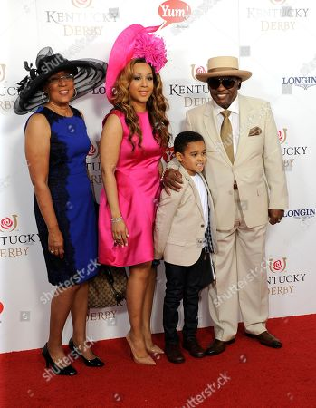 Ron Isley (right) and guests arrive on the red carpet at the 2015 Kentucky Derby on at Churchill Downs in Louisville, Ky
