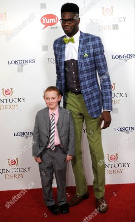 Nerlens Noel (right) and Kelly Melton arrive on the red carpet at the 2015 Kentucky Derby on at Churchill Downs in Louisville, Ky
