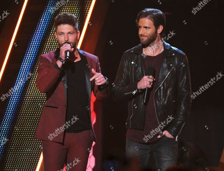 Chris Lane, left, and Canaan Smith speak during the American Country Countdown Awards at the Forum on in Inglewood, Calif