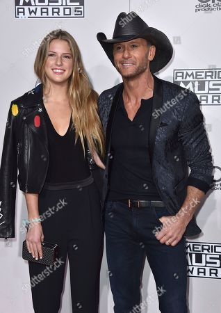 Stock Image of Tim McGraw, right, and Maggie Mcgraw arrive at the American Music Awards at the Microsoft Theater, in Los Angeles