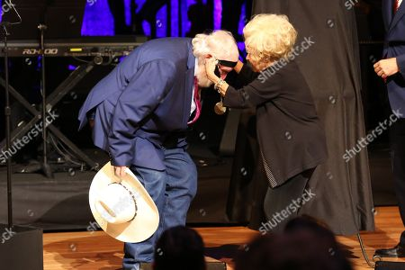 From left, artist Charlie Daniels is presented with a medallion by artist Brenda Lee at the Country Music Hall of Fame Medallion Ceremony at the Country Music Hall of Fame and Museum on in Nashville, Tenn