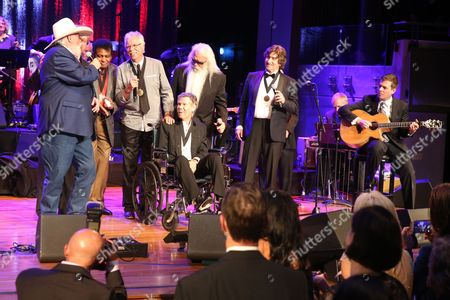 """From left, artists Charlie Daniels, Duane Allen, Charley Pride, Joe Bonsall, Randy Travis, William Lee Golden, and Richard Sterban sing """"Will the Circle Be Unbroken?"""" at the close of the Country Music Hall of Fame Medallion Ceremony at the Country Music Hall of Fame and Museum on in Nashville, Tenn"""