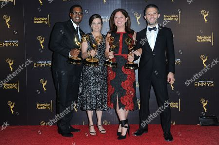 Jayson Jackson, from left, Amy Hobby, Liz Garbus, and Justin Wilkes from What Happened, Miss Simone? pose in the press room with their award for outstanding documentary or nonfiction special during night two of the Creative Arts Emmy Awards at the Microsoft Theater, in Los Angeles
