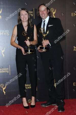 Schuyler Telleen, right, and Katherine Isom pose in the press with their award for outstanding production design for a variety, nonfiction, reality or reality-competition series for Portlandia room during night two of the Creative Arts Emmy Awards at the Microsoft Theater, in Los Angeles