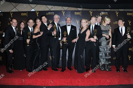 """Stock Photo of David Wain, third from left, Ken Morino, Erinn Hayes, Keith Crofford, Rob Corddry, Zandy Hartig, Rob Huebel, Krister Johnson, Lake Bell, Jonathan Stern, and team pose in the press room with the award for outstanding short form comedy or drama series for """"Children's Hospital"""" during night two of the Creative Arts Emmy Awards at the Microsoft Theater, in Los Angeles"""