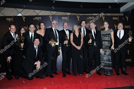 "David Wain, third from left, Ken Morino, Erinn Hayes, Keith Crofford, Rob Corddry, Zandy Hartig, Rob Huebel, Krister Johnson, Lake Bell, Jonathan Stern, and team pose in the press room with the award for outstanding short form comedy or drama series for ""Children's Hospital"" during night two of the Creative Arts Emmy Awards at the Microsoft Theater, in Los Angeles"
