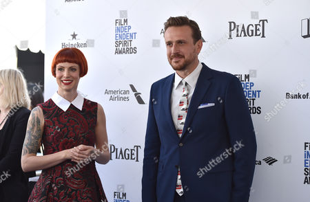 Jason Segel, right, and Alexis Mixter arrive at the Film Independent Spirit Awards, in Santa Monica, Calif