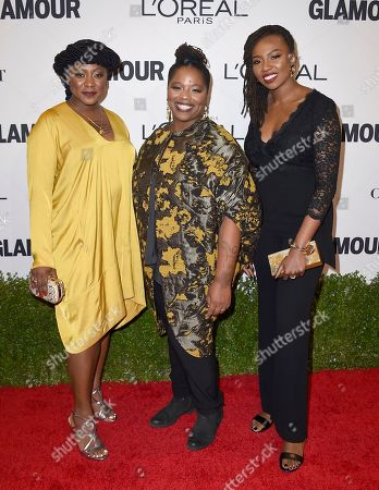 Alicia Garza, from left, Patrisse Cullors and Opal Tometi, co-founders of the Black Lives Matter movement, arrive at the Glamour Women of the Year Awards at NeueHouse Hollywood, in Los Angeles
