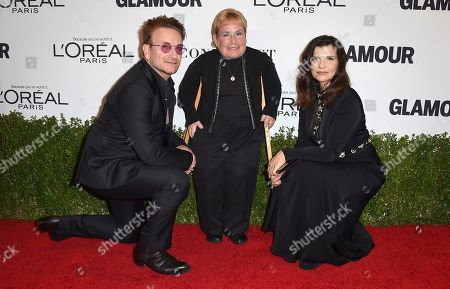 Bono, from left, Caterpillar Foundation President Michele Sullivan and Ali Hewson arrive at the Glamour Women of the Year Awards at NeueHouse Hollywood, in Los Angeles