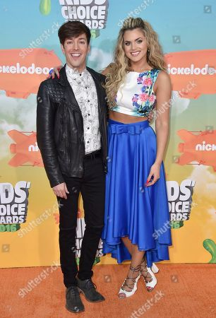 Roger Gonzalez, left, and Isabella Castillo arrive at the Kids' Choice Awards at The Forum, in Inglewood, Calif