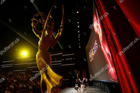 A large Emmy award statue is seen on stage in front of the audience while moderator Shawn Ryan, Moira Demos, Kabir Akhtar, ACE, Robert Malachowski, ACE, Kelley Dixon, ACE, Stephen Prime and Nena Erb participate during the 2016 Prime Cuts hosted by the Television Academy in the Wolf Theater on in the NoHo Arts District in Los Angeles