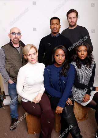 "Clockwise from top left, actors Jackie Earle Haley, actor, director and producer, Nate Parker, actor Armie Hammer, Gabrielle Union, Aja Naomi King and Penelope Ann Miller pose for a portrait to promote the film, ""The Birth of a Nation,"" at the Toyota Mirai Music Lodge during the Sundance Film Festival on in Park City, Utah"