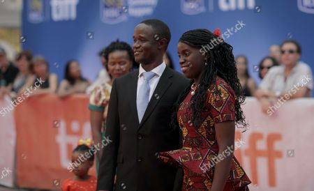 Robert Katende and Phiona Mutesi attend the Queen of Katwe premiere on day 3 of the Toronto International Film Festival at Roy Thomson Hall, in Toronto