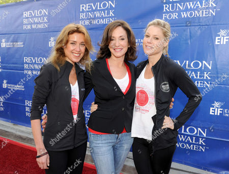 CMO of Revlon Julia Goldin, left, Lilly Tartikoff and Julie Bowen, right, arrive at the 20th Annual EIF Revlon Run/Walk For Women held at Los Angeles Memorial Coliseum at Exposition Park on in Los Angeles, California
