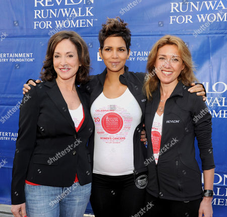 Lilly Tartikoff, left, Halle Berry and CMO of Revlon Julia Goldin, right, arrive at the 20th Annual EIF Revlon Run/Walk For Women held at Los Angeles Memorial Coliseum at Exposition Park on in Los Angeles, California