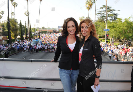 Lilly Tartikoff, left, and CMO of Revlon Julia Goldin attend the 20th Annual EIF Revlon Run/Walk For Women held at Los Angeles Memorial Coliseum at Exposition Park on in Los Angeles, California