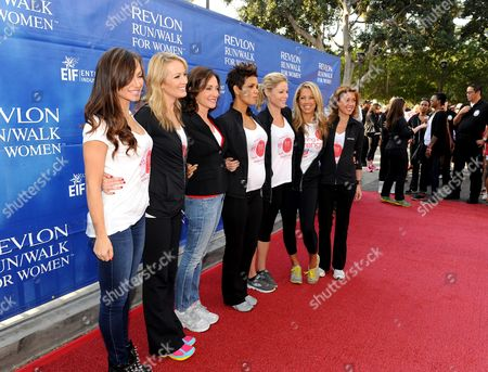 L-R) Brooke Anderson, Lilly Tartikoff, Halle Berry, Julie Bowen, Denise Austin and Julia Goldin arrive at the 20th Annual EIF Revlon Run/Walk For Women held at Los Angeles Memorial Coliseum at Exposition Park on in Los Angeles, California