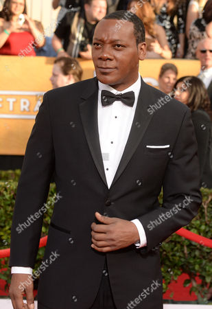 Eric LaRay Harvey arrives at the 20th annual Screen Actors Guild Awards at the Shrine Auditorium, in Los Angeles