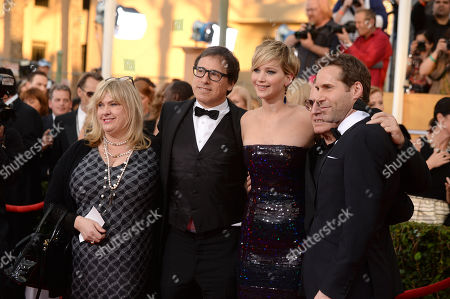 From left, Colleen, Camp, David O. Russell, Jennifer Lawrence, Paul Herman, and Alessandro Nivola arrive at the 20th annual Screen Actors Guild Awards at the Shrine Auditorium, in Los Angeles