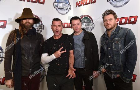 Chris Traynor, from left, Gavin Rossdale, Robin Goodridge and Corey Britz, of Bush, pose in the press room at the 25th annual KROQ Almost Acoustic Christmas at The Forum, in Inglewood, Calif