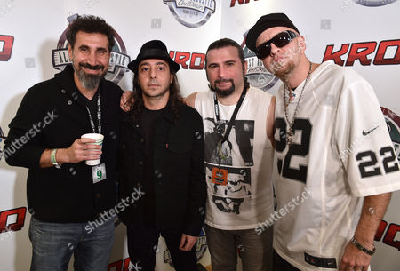 Serj Tankian, from left, Daron Malakian, John Dolmayan and Shavo Odadjian, of System of a Down, pose in the press room at the 25th annual KROQ Almost Acoustic Christmas at The Forum, in Inglewood, Calif
