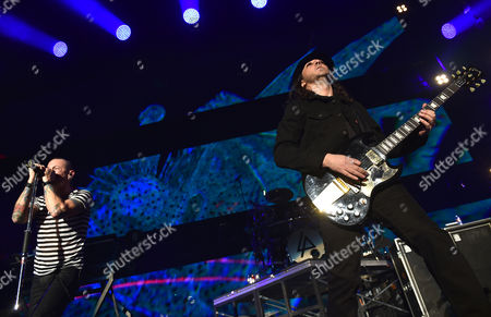 Chester Bennington, of Linkin Park, left, and Daron Malakian, of System of a Down, perform at the 25th annual KROQ Almost Acoustic Christmas at The Forum, in Inglewood, Calif