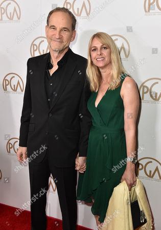 Marshall Herskovitz, left, and Landry Major arrive at the 27th annual Producers Guild Awards at the Hyatt Regency Century Plaza, in Los Angeles