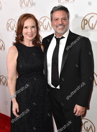 PGA Chairs Jennifer Todd, left, and Michael De Luca arrive at the 27th annual Producers Guild Awards at the Hyatt Regency Century Plaza, in Los Angeles